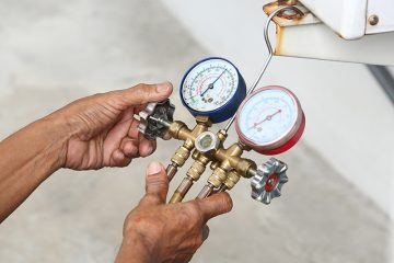 HVAC Technician inspecting refrigerant pressure of airconditioner