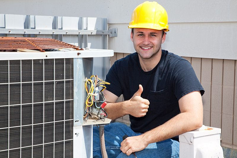 Air Conditioner Repairman giving thumbs up signal