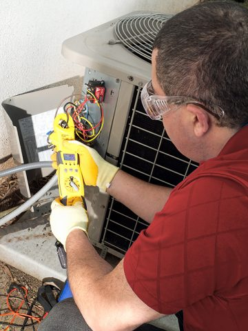 HVAC Technician performing maintenance